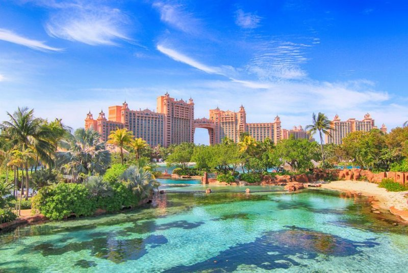 The Royal at Atlantis. This iconic tower's lobby features The Dig and Ruins Lagoon, a large open-air marine habitat. Located in the Atlantis Paradise Resort and Casino
