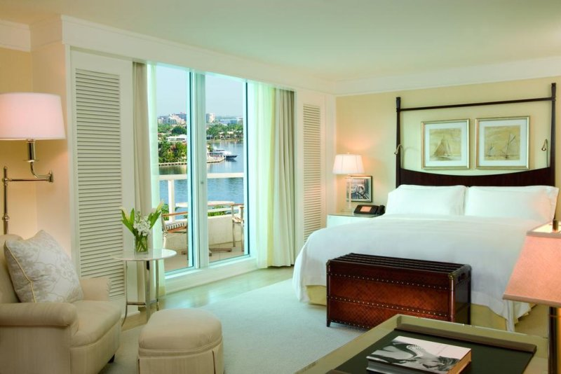 The Ritz-Carlton, Fort Lauderdale. Each room is remarkably contemporary, yet traditionally elegant, with relaxing champagne hues, and french doors leading out to large balconies overlooking the coastline.