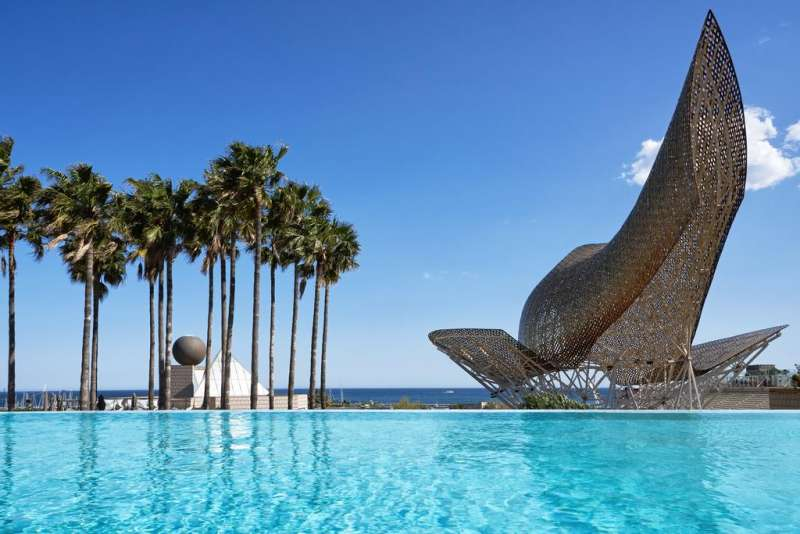 Hotel Arts Barcelona. Overlooking Barceloneta Beach and Barcelona city center, this design hotel has 2 outdoor pools and luxury spa with panoramic city views. #beach
